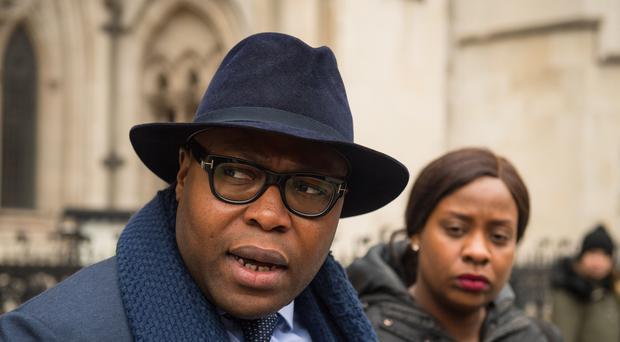 Isaiah Haastrup's father Lanre Haastrup and mother Takesha Thomas speak to the media outside the Royal Courts of Justice (Dominic Lipinski/PA)