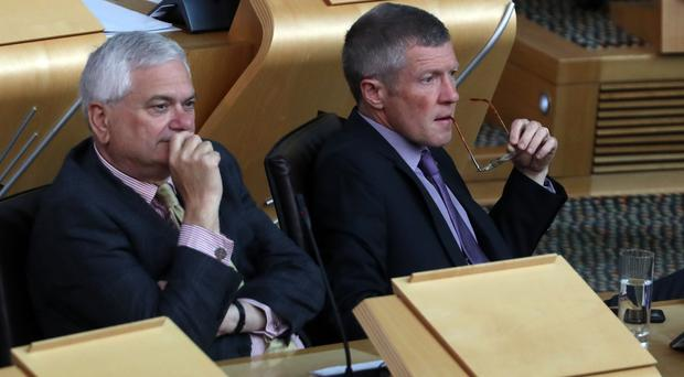 Scottish Liberal Democrat leader Willie Rennie (r) calls for government action on university pensions (Andrew Milligan/PA)