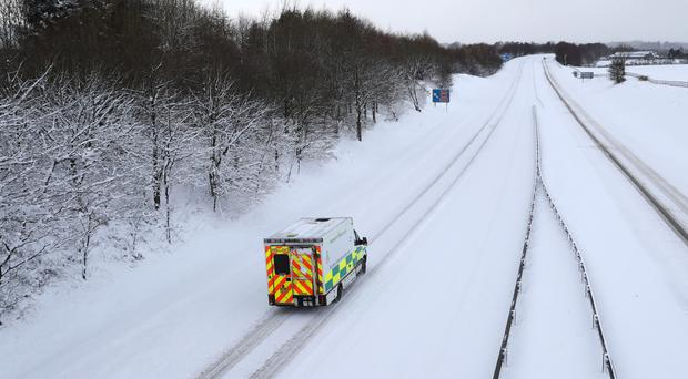 An ambulance on the M876 (Andrew Milligan/PA)