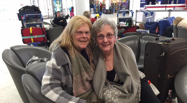 Jane Scott and Marjory Russell are planning to stay a second night in Glasgow Airport (Paul Ward/PA)