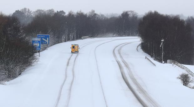 An ambulance on the M876 in snowy conditions, near Falkirk (Andrew Milligan/PA)