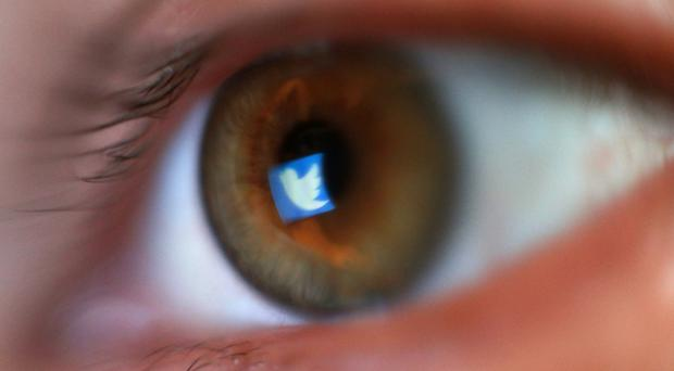 Twitter is looking to make conversations on the site 'healthier'. (Yui Mok/PA)