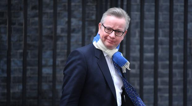 Michael Gove has taken water company bosses to task over environmental and financial standards (Victoria Jones/PA)