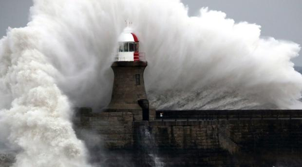 Giant waves crash over Souter Lighthouse in South Shields (Owen Humphreys/PA)