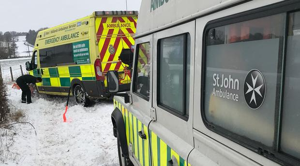 St John Ambulance volunteers help in the snow