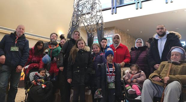 Organiser Angie Mays with some of the families from the Grenfell Tower community who enjoyed an overnight stay at Chessington Zoo (Angie Mays/PA)