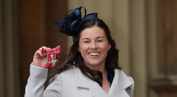 England cricketer Tamsin Beaumont with her MBE (Yui Mok/PA)