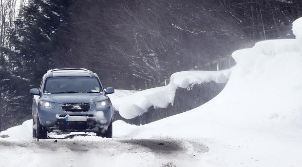 Drivers face difficult conditions on the roads (Niall Carson/PA)