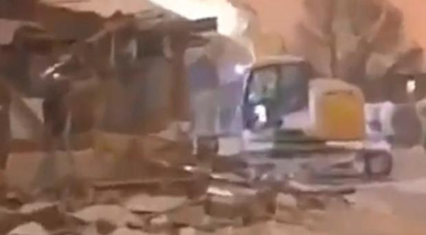 Video footage on social media shows a digger outside the supermarket