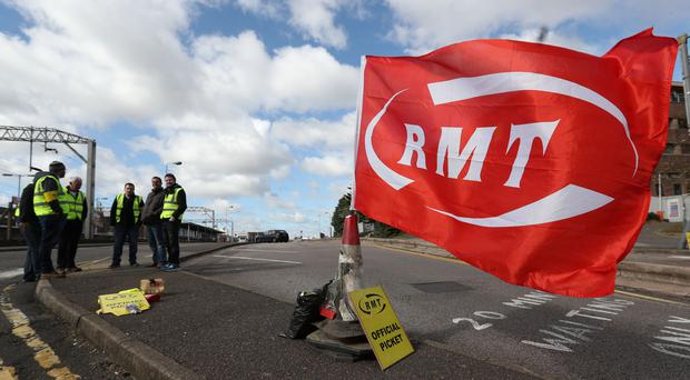 Members of the RMT union on the picket line as they stage a 24-hour strike (Jonathan Brady/PA)