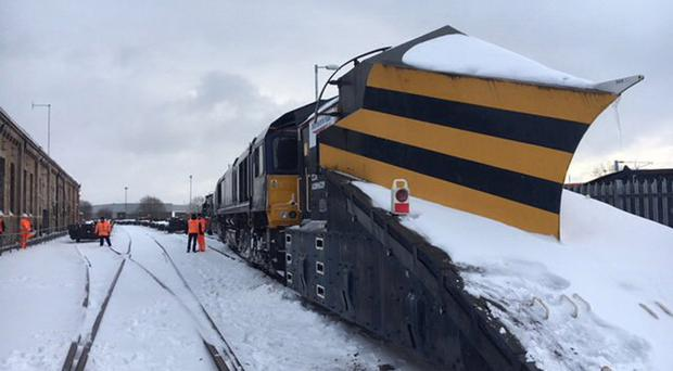 Massive snow ploughs are being used to clear rail tracks across Scotland (NetworkRail Scotland/PA)