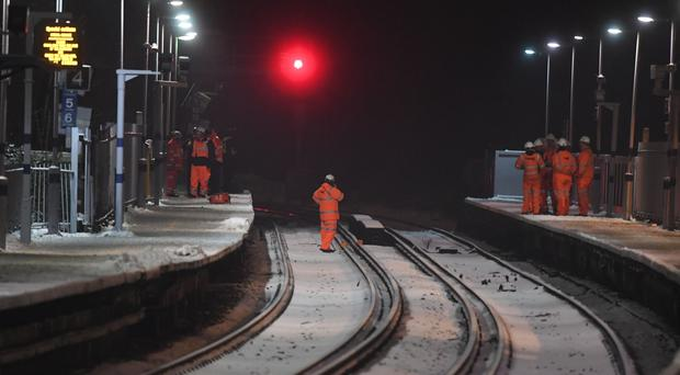 Rail engineers at Lewisham station after passengers frustrated by delays jumped from trains and walked down tracks near the station in south London (Victoria Jones/PA)