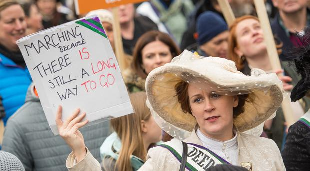 A marcher dressed as a suffragette during the March4Women in Westminster, London (Dominic Lipinski/PA)