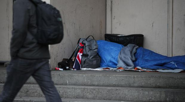 File photo dated 07/02/17 of a person sleeping rough in a doorway. (Yui Mok/PA)