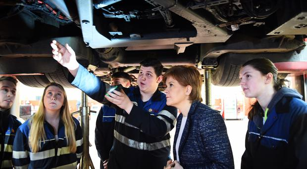 Nicola Sturgeon (second right) meets apprentices at the Lothian Bus central garage in Edinburgh (Andy Buchanan/PA)