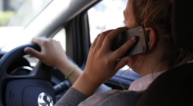 Harsher penalties could be introduced for using mobile phones while driving