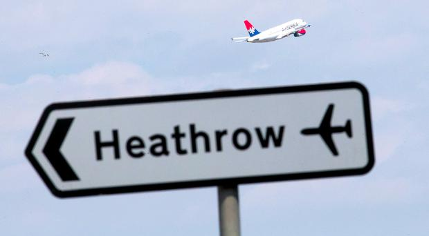 The cost of expanding Heathrow has been attacked (Daniel Leal-Olivas/PA)