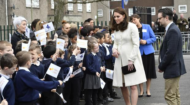 The Duchess of Cambridge meets schoolchildren during a visit to Pegasus Primary School in Oxford (Arthur Edwards/Sun/PA)