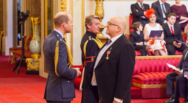 John Godber, was given an OBE by the Duke of Cambridge for services to the arts at Buckingham Palace (Dominic Lipinski/PA)