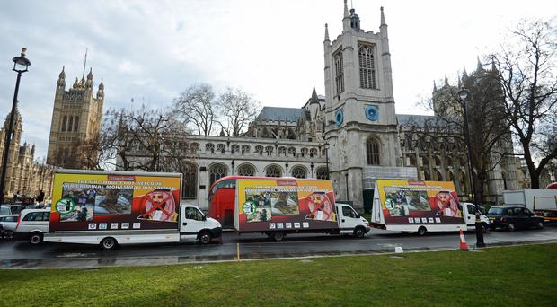 Three billboards protesting against the visit by Saudi Arabia's Crown Prince Mohammed bin Salman are driven around Parliament Square (Kirsty O'Connor/PA)