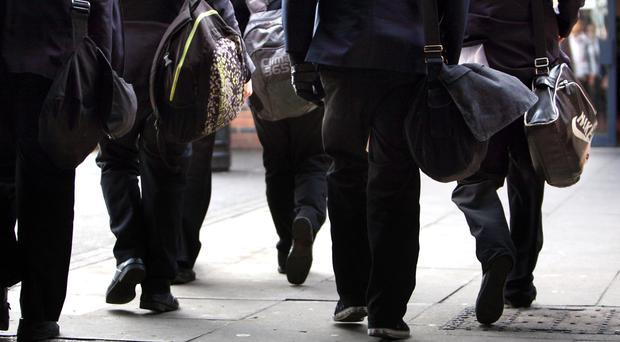 Decisions over issues such as school uniform may need to be taken by councils, academy sponsors and central government rather than schools, the Ofsted chief inspector has said (David Jones/PA)