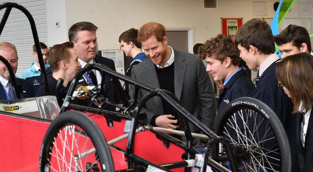 Prince Harry talks to students and apprentices who made a soap box cart, during a visit to the Silverstone Circuit in Northamptonshire (Arthur Edwards/The Sun)