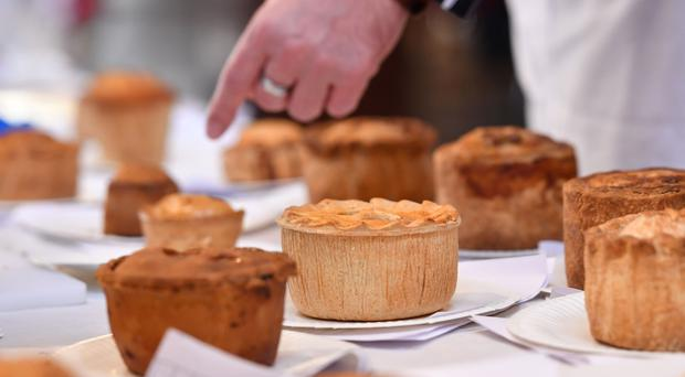 An array of pies are judged during the British Pie Awards at St Mary's Church in Melton Mowbray (Joe Gioddens/PA)