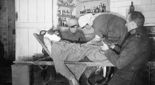Elsie Knocker and Mairi Chisholm with a Belgian orderly operating on a wounded soldier (Imperial War Museum/PA