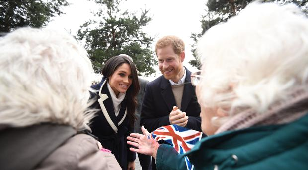 Prince Harry and Meghan Markle talk to sisters Jean Dickinson and Irene Gould during a visit to Birmingham (Victoria Jones/PA)