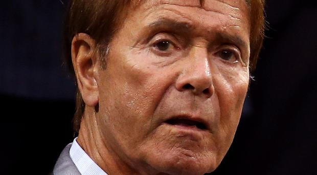 Sir Cliff Richard is suing the BBC over coverage of a raid at his apartment (Steve Paston/PA)