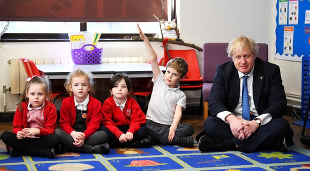 Foreign Secretary Boris Johnson sits with pupils on a visit to St Leonard's Church of England Primary Academy in Hastings to highlight his commitment to girls' education (Dylan Martinez/PA)