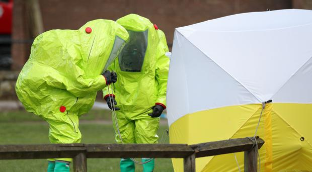 Officers in hazmat suits work to secure a tent covering a bench in the Maltings shopping centre in Salisbury, where former Russian double agent Sergei Skripal and his daughter Yulia were found critically ill by exposure to a nerve agent (Andrew Matthews/PA)