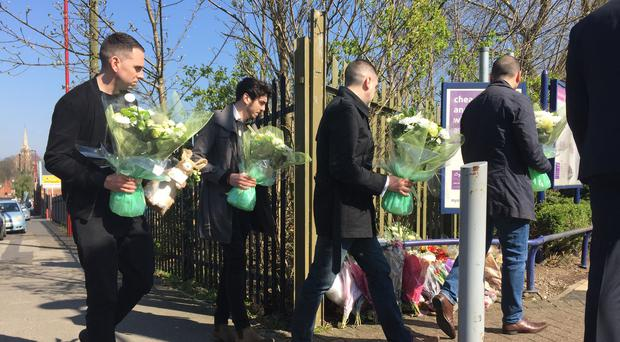 Grieving brothers (left to right) James, Jack, Tom and Lee Banting, placed flowers at the tram stop in Birmingham (Richard Vernalls/PA)