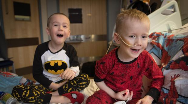 Brothers, four-year-old Ollie (right) and Finley Cripps, six, from Sittingbourne, Kent, at the Royal Marsden hospital in Surrey, after Finley donated his stem cells to his brother (Stefan Rousseau/PA)