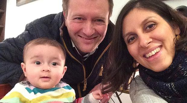 Nazanin Zaghari-Ratcliffe with her husband and daughter