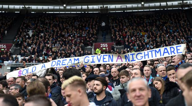 West Ham United fans hold up a banner reading 'Sold a dream given a nightmare' during the Premier League match at the London Stadium.