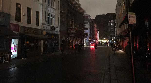 Old Compton Street in Soho, central London in darkness following a power cut (PA Wire / Ryan Hooper)