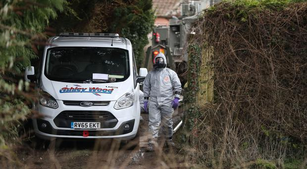 Investigators in protective clothing remove a van from an address in Winterslow near Salisbury in Wiltshire (Andrew Matthews/PA)