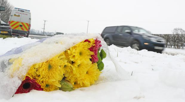 Flowers at the scene on the A61 near Thirsk in North Yorkshire (Owen Humphreys/PA)