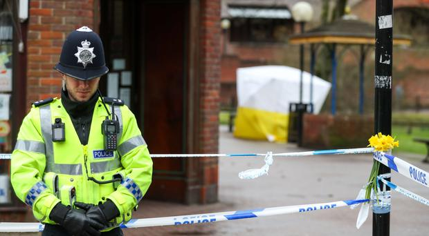A policeman next to a cordon near to a bench in the Maltings in Salisbury (Andrew Matthews/PA)