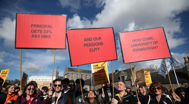 University staff are joined by politicians and students as they hold a rally outside the Scottish Parliament in Edinburgh (Jane Barlow/PA)