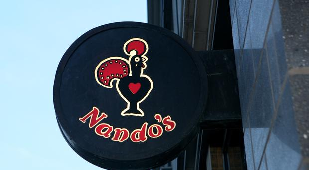 Nando's says the independent shop's name and logo is too similar to its own (Katie Collins/PA)