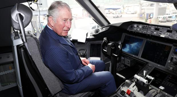 The Prince of Wales is shown the cockpit of a British Airways 787 aircraft during a visit to Heathrow Airport (Chris Jackson/PA)