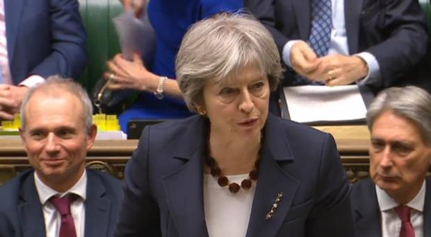 Theresa May tells MPs the UK is to expel 23 Russian diplomats in retaliation for the nerve gas attack in Salisbury (PA)