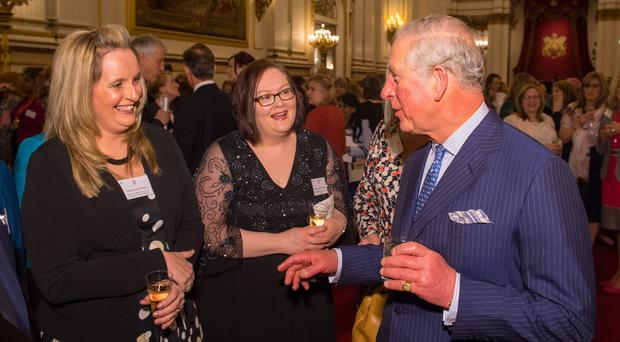 The Prince of Wales meets Royal College of Nursing Nurse of the Year Melanie Davies (left) at a reception at Buckingham Palace (Dominic Lipinski/PA)