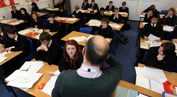 Secondary schools are set to see pupils numbers rise by more than 600,000 over the next few years, figures suggest (David Davies/PA)