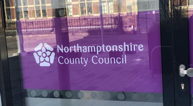 A report recommends Northamptonshire County Council be partitioned into two new unitary councils (PA)