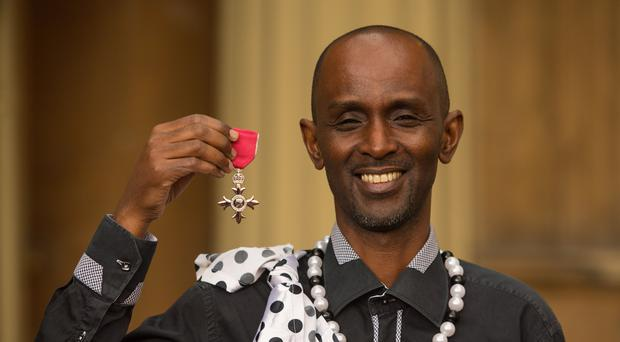 Eric Murangwa Eugene with his MBE medal, awarded by the Prince of Wales, following an investiture ceremony at Buckingham Palace in London (Dominic Lipinski/PA)