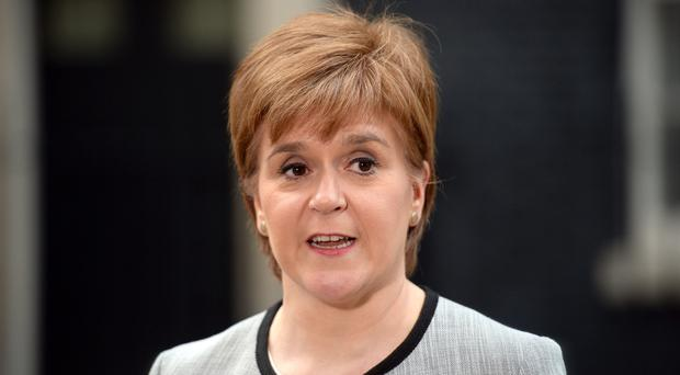 First Minister Nicola Sturgeon said she is 'disappointed' by the scrapping of the Football Act (Kirsty O'Connor/PA)