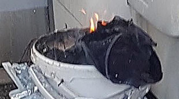 Picture issued by Sylvain Pennec of a bucket on fire on a tube train at Parsons Green station